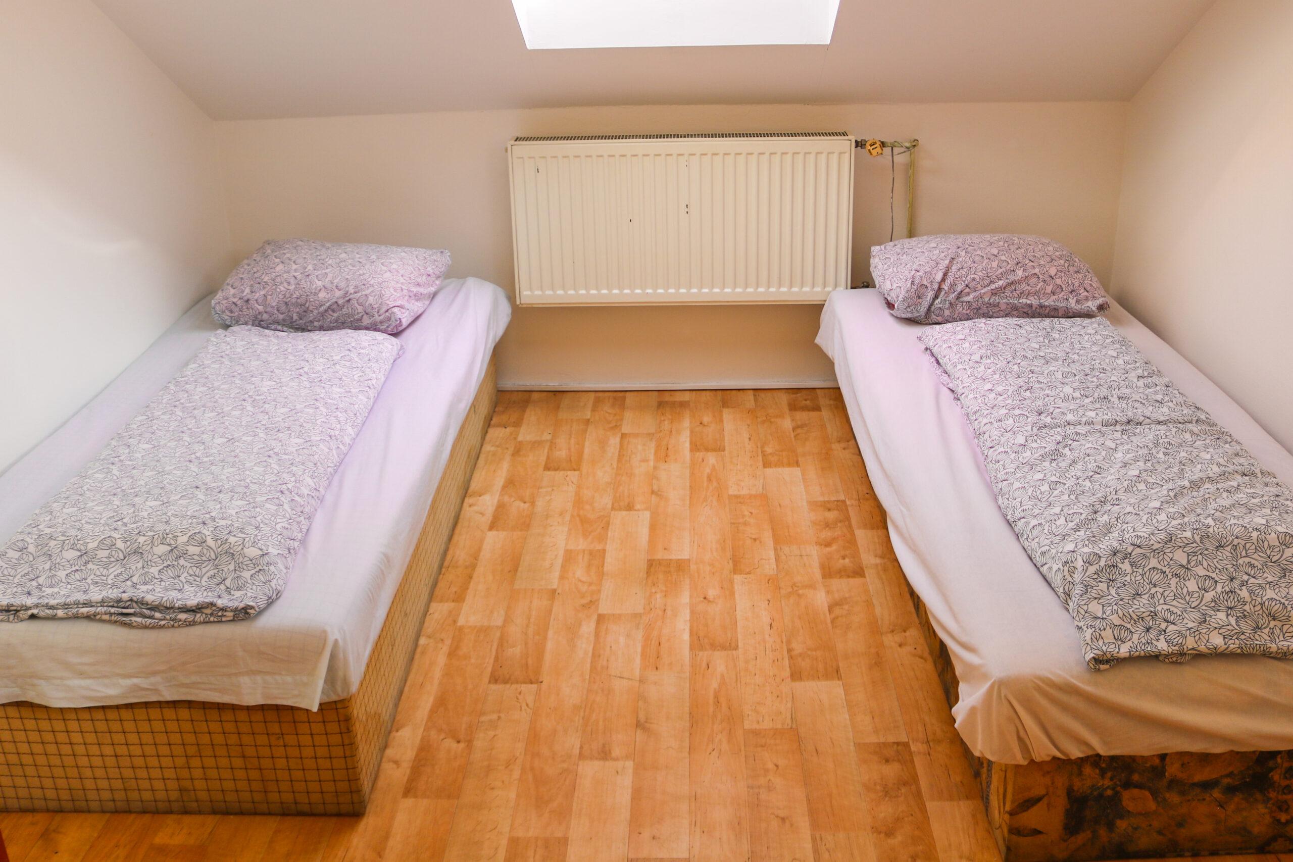 Dvě single postele v apartmánu 7 v ubytování Hajírna Opava
